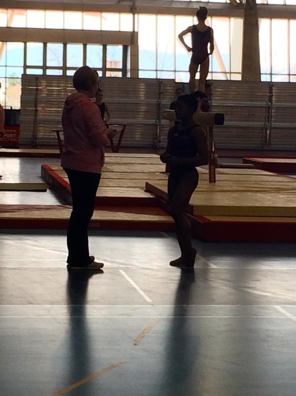 Aimee Boorman and Simone Biles preparing for beam.