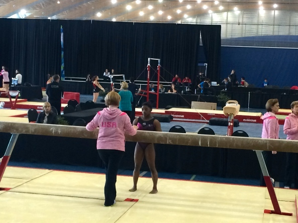 Aimee Boorman and Simone Biles preparing for beam.